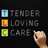 "blackboard with the words: ""Tender, Loving, Care"""
