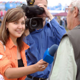 television reporter interviewing someone