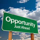 """sign that says """"Opportunity Just Ahead"""""""