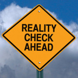 "Warning sign with words ""Reality Check Ahead"""