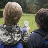 two boys using a compass