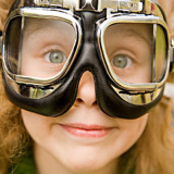 girl wearing motorcycle glasses