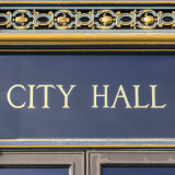 "words ""City Hall"" over entry door"