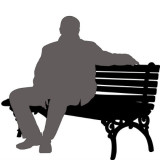 Silhouette of man sitting on a bench