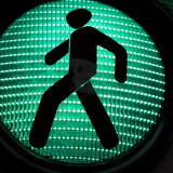 green pedestrian crossing signal
