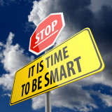 "stop sign with words ""It is Time to Be Smart"""