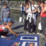 Painter draws a crowd along the waterfront in Victoria, British Columbia
