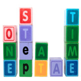 "stack of building blocks spelling out ""one step at a time"""