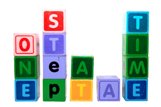 "building blocks spell out ""one step at a time"""