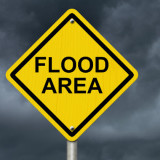 "road sign that says ""flood area"""