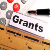 File folder with the word grants on a tab