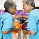 Man and woman bowling together