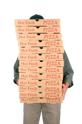 delivery of large stack of pizzas