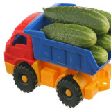 illustration of toy food truck carrying load of cucumbers