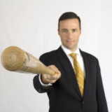 Businessman pointing a baseball bat