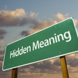 "road warning sign with words ""Hidden Meaning"""