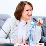 photo of woman chairing a meeting