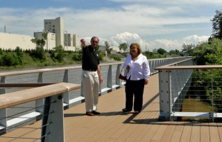 John Swanson and Olga Velazquez on boardwalk along Burns Waterway