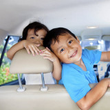 children in back seat of a car