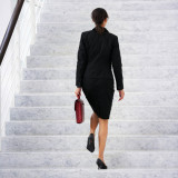businesswoman climbing a flight of stairs