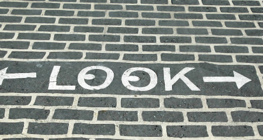 Look sign on pavement