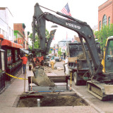 Tree being planted in sidewalk on Church Street in downtown Burlington, Vermont.