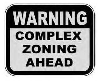 sign that says Warning: Complex Zoning Ahead