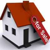 3-D rendering of small house with for sale tag