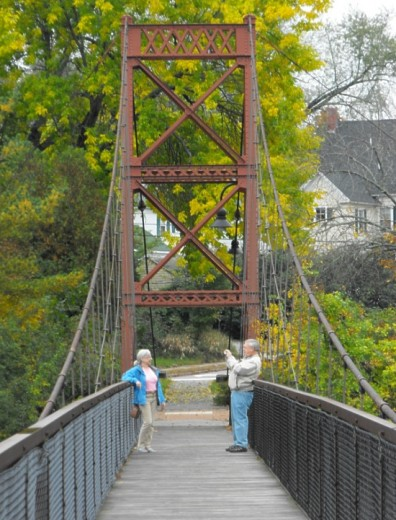 Couple taking photographs on Swinging Bridge