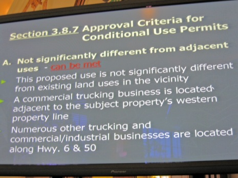 Application criteria displayed on monitor at planning commission meeting