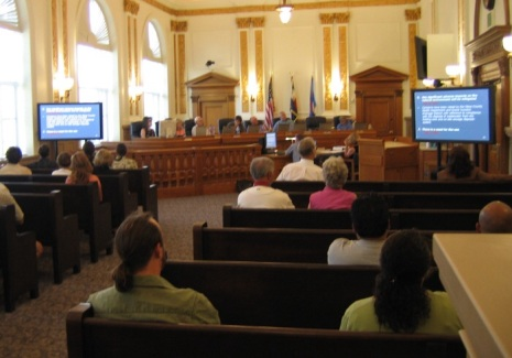 Large monitors display information at Mesa County, Colorado, Planning Commission meeting.