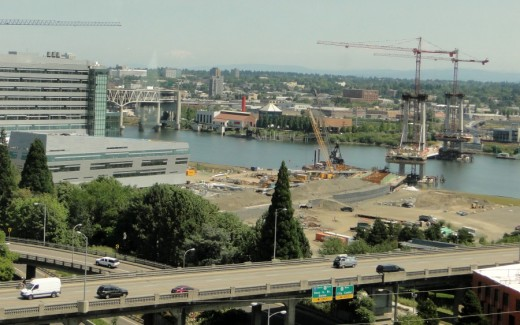 "View from Portland's aerial tram towards the Willamette River. The new ""Caruthers Bridge"" will host the  7.3-mile MAX light rail Orange Line, when it opens in September 2015. Pedestrians. Only trains, buses, streetcars, pedestrians and bicyclists will be able to use the bridge. As noted in an article in The Oregonian newapaper (Dec. 8, 2010), ""it will be the nation's largest no-automobile urban crossing."""