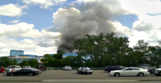 Smoke billowing from paper mill fire.