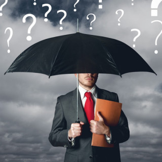 image of businessman under umbrella on stormy day