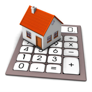 image of a house sitting on a calculator