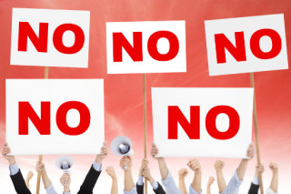 "illustration of crowd of people holding ""NO"" signs"