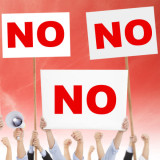 "people holding up ""NO"" signs"