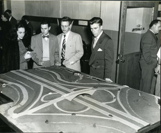 Our cities are still dealing with the aftermath of America's romance with the highway. Photo of model of Four Leaf Clover Highway Intersection at Engineers' Show, 1950.