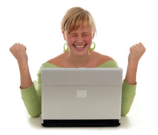 Good news - a woman in front of laptop